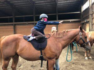 Laura jumping a school horse at Farpoint Farm